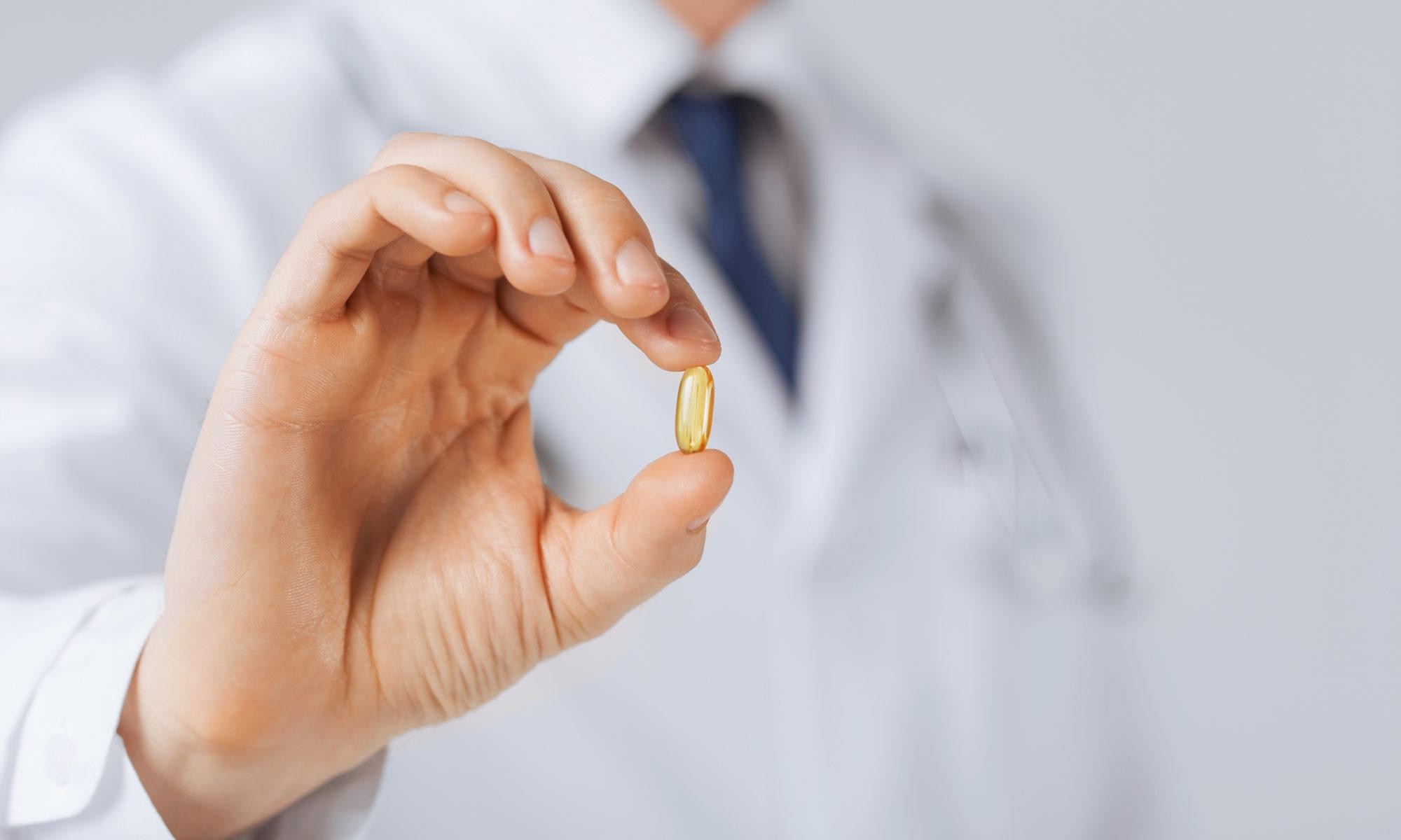 Omesam capsule in doctor hand